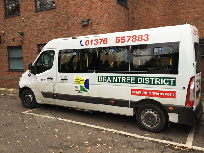 A community transport minibus parked outside the Council's building