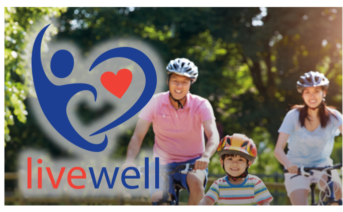 Livewell logo on image of a family on bikes on the forest
