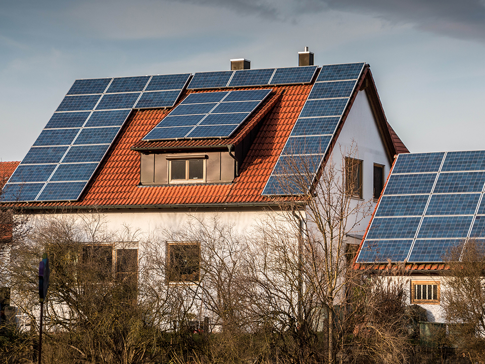 modern house with solar panels on roof